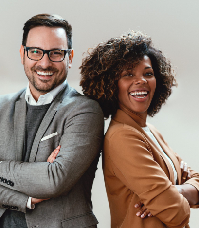 Portrait of cheerful multi ethnic business couple wearing suit and looking at camera